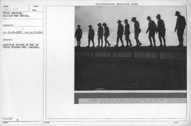 American troops on top of their Nissen Hut. Camiers. 11-7-1918