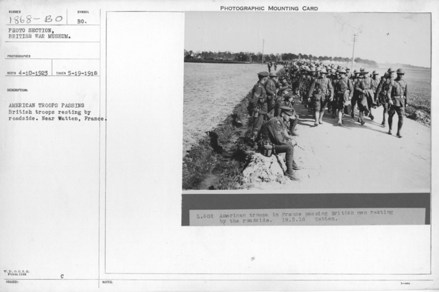 American troops passing British troops resting by roadside. Near Watten, France