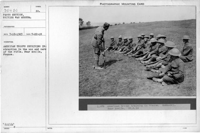 American troops receiving instruction in the use and care of the rifle. Near Moulle, France; 5/22/1918