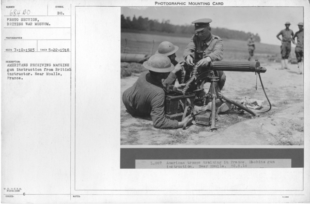 Americans receiving machine gun instruction from British instructor. Near Moulle, France. 5-22-1918