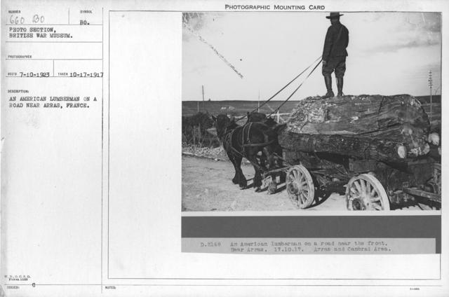 An American lumberman on a road near Arras, France. 10-17-1917