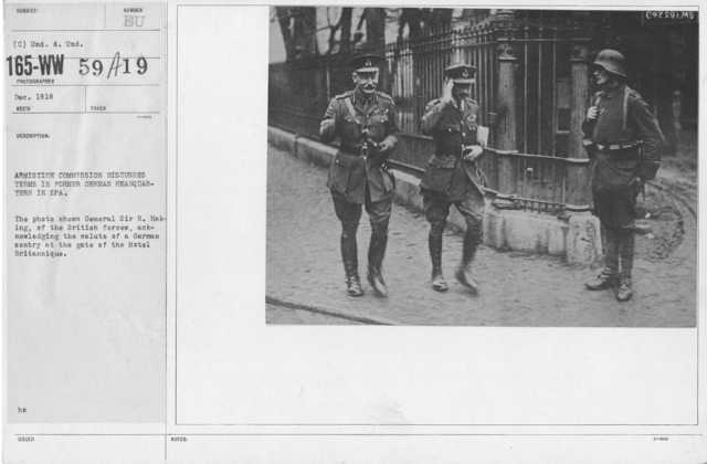 Armistice - Armistice - Armistice Commission discusses terms in former German Headquarters in Spa. The phot shows General Sir R. Haking, of the British froces, acknowledging the salute of a German sentry at the gate of the Hotel Britannique