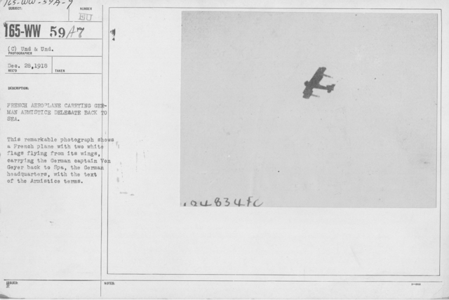 Armistice - Armistice - French aeroplane carrying Germany Armistice delegate back to sea. This remarkable photograph shows a French plane with two white flags flying from its wings, carrying the German captain Von Geyer back to Spa, the German headquarters, with the text of the Armistice terms
