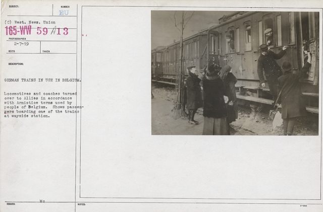 Armistice - Armistice - German trains in use in Belgium. Locomotives and coaches turned over to Allies in accordance with Armistice terms used by people of Belgium. Shows passengers boarding one of the trains at wayside station