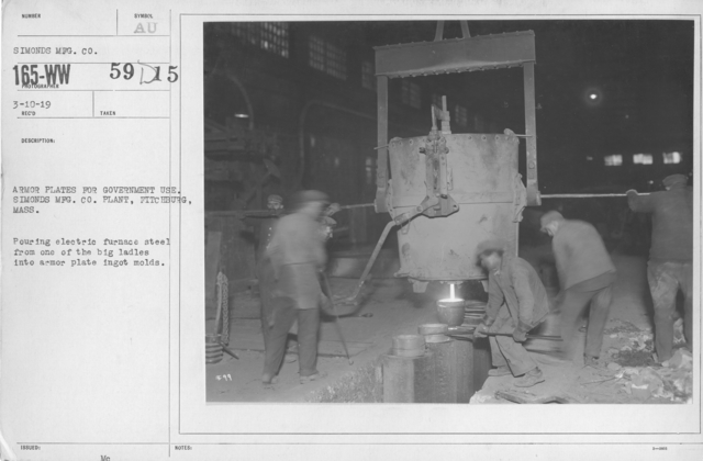 Armor - Armored Vehicles - Armor plates for government use. Simonds Mfg. Co. Plant, Fitchburg, Mass. Pouring electric furnace steel from one of the big ladles into armor plate ingot molds