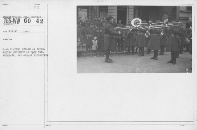 Army of Occupation - Band playing before an interesting audience of 69th Infantrymen, and German youngsters