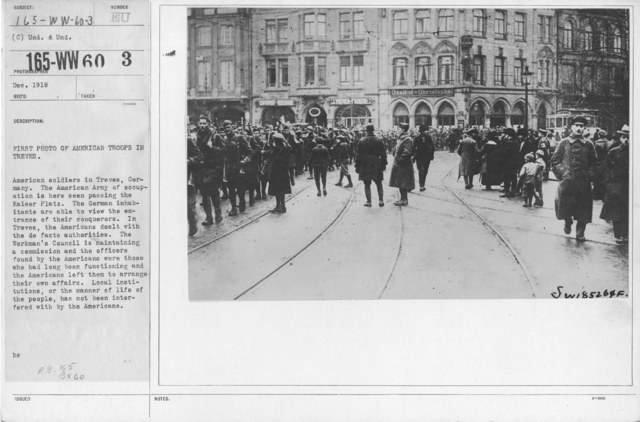 Army of Occupation - First photo of American troops in Treves. American soldiers in Treves, Germany. The American Army of occupation is here seen passing the Kaiser Platz. The German inhabitants are able to view the entrance are able to view the entrance of their conquerors. In Treves, the Americans dealt with the de facto authorities. The Workman's Council is maintaining a commission and the officers found by the Americans were those who had long been functioning and the American sleft them to arrange their own affairs. Local institutions, or the manner of life of the people, has not been interfered with by the Americans