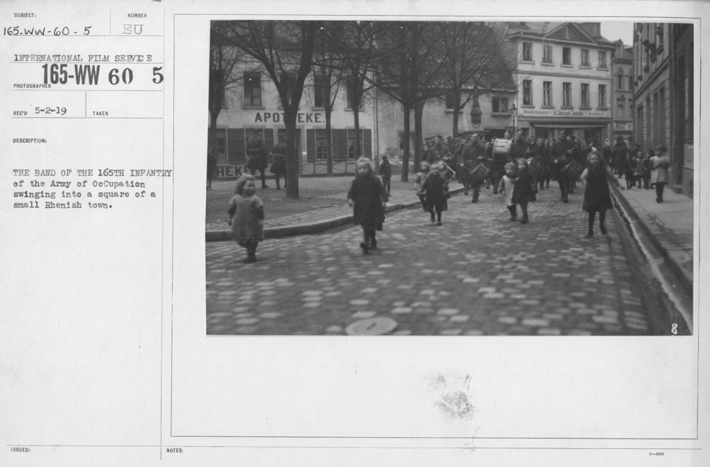 Army of Occupation - The band of 165th Infantry of the Army of Occupation swinging into a square of a small Rhenish town