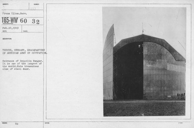 Army of Occupation - Treves, Germany, Headquarters of American Army of Occupation. Entrance of Zeppelin Hangar. It is one of the largest of the world. Note tremendous size of steel door