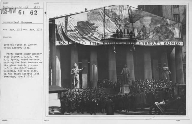 Artists - Artists paint to assist Third Liberty Loan. Photo shows Henry Reuterdahl (Lieut. U.S.N.R.) and M.C. Wyeth, noted artists, putting the last touches on the giant battle picture before the Sub-Treasury building, New York City, in the third Liberty Loan campaign, April 1918