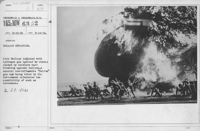 """Balloons - Accidents & Wrecks - Balloon Explosion. Kite Balloon inflated with hydrogen gas ignited by static caused by soldiers hair brushing against balloon . A special non-inflammable """"Helium"""" gas now being tried by the Government elimates the possibility of such an occurance"""