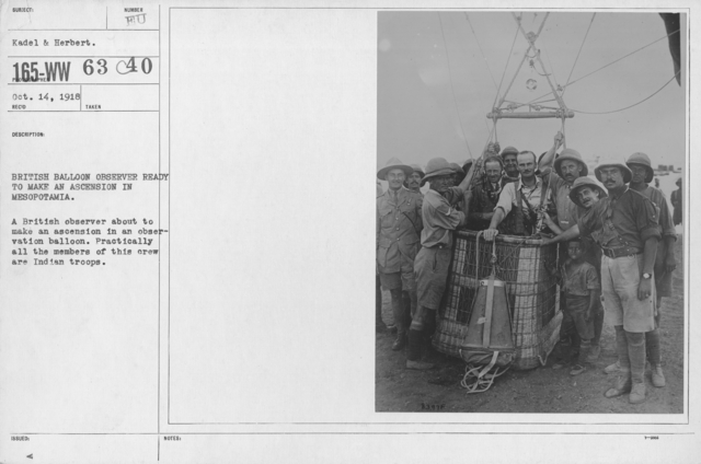 Balloons - Flights - British Balloon observer ready to make an ascension in Mesopotamia. A British observer about to make an ascension in an observation balloon. Practically all the members of this crew are Indian troops