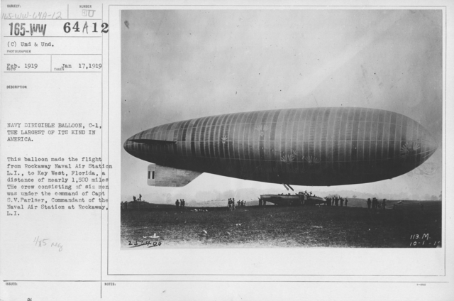 Balloons - Hangars and Beds - Navy Dirigible Balloon, C-1, the largest of its kind in America. This balloon made the flight from Rockaway Naval Air Station L.I., to Key West, Florida, a ditance of nearly 1,500 miles. The crew consisting of six men was under the command of Capt. S.V. Parsler, Commandant of the Naval Air Station at Rockaway, L.I