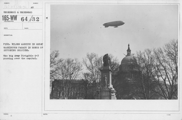 Balloons - Hangars and Beds - President Wilson marches in great Washington Parade in honor of returning soldiers. The big Army Dirigible C-3 passing over the capitol