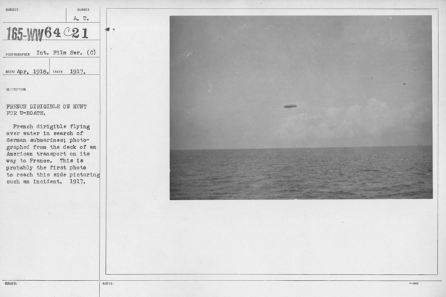 Balloons - In the Theatre of Operations - French dirigible on hunt for U-boats. French dirigible flying over water in search of German submarines; photographed from the deck of an American transport on its way to France. This is probably the first photo to reach this side picturing such an incident