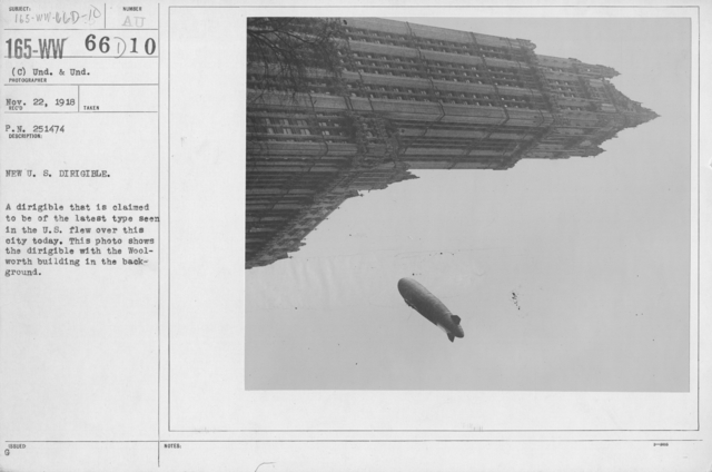 Balloons - Miscellaneous - New U.S. Dirigible. A dirigible that is claimed to be of the latest type seen in the U.S. flew over this city today. This photo shows the dirigible with the Woolworth building in the background