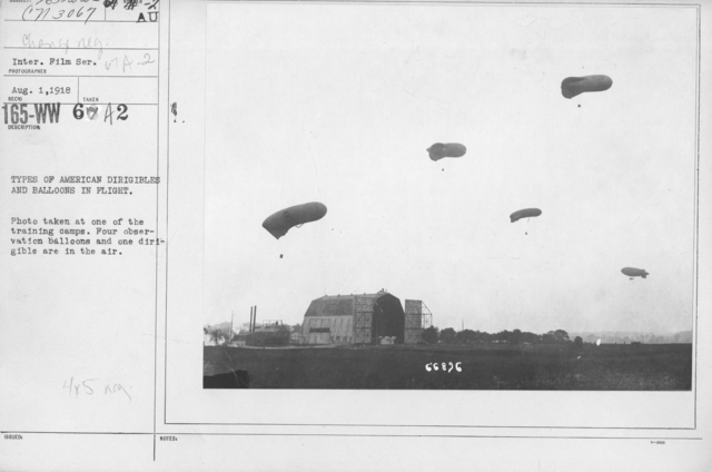 Balloons - Observation - Types of American Dirigibles and balloons in flight. Photo taken at one of the training camps. Four observation balloons and one dirigible are in the air