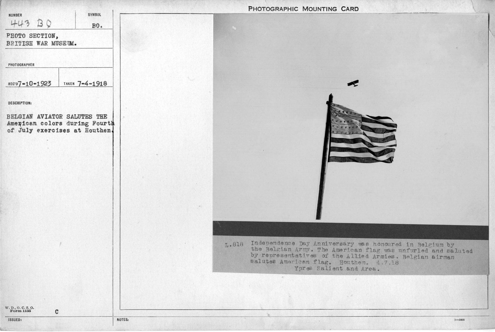 Belgium aviator salutes the American colors during Fourth of July exercises at Houthem; 7/4/1918