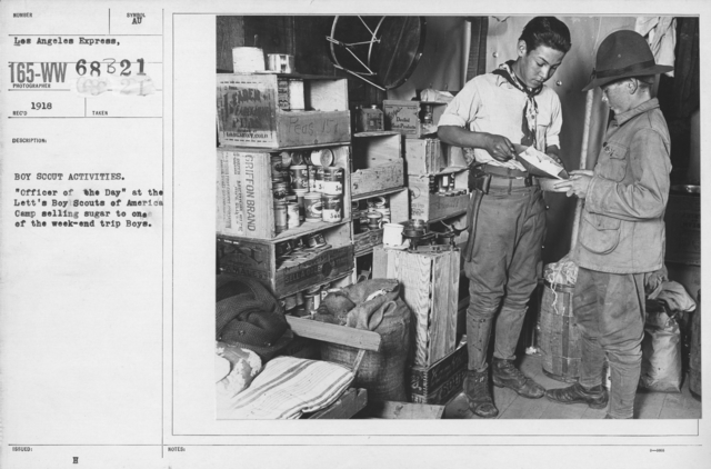 """Boy's Activities - Drills - Boy Scout Activities. """"Officer of the Day"""" at the Lett's Boy Scouts of America Camp selling sugar to one of the weekend trip Boys"""
