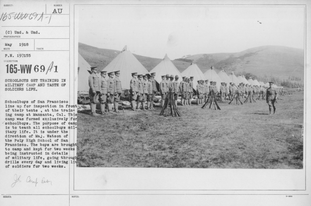 Boy's Activities - Junior Camp Association - Schoolboys get training in military camp and taste of soldiers life. Schoolboys of San Francisco line up for inspection in front of their tents, at the training camp at Manzanta, Cal. This camp was formed was formed exclusively for schoolboys. The purpose of camp is to teach all schoolboys military life. It is under the direction of Major Watsonof the Poly High School of San Francisco. The boys are brought to camp and kept for two weeks being instructed in details of military life, going through drills every day and living lives of soldiers for two weeks