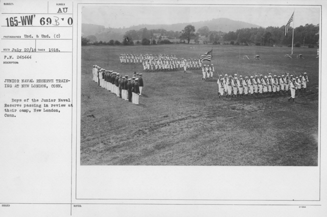 Boy's Activities - Junior Naval Reserve - Camp Dewey, Conn. - Junior Naval Reserve Training at New London, Conn. Boys of the Junior Naval Reserve passing in review at their camp, New London, Conn