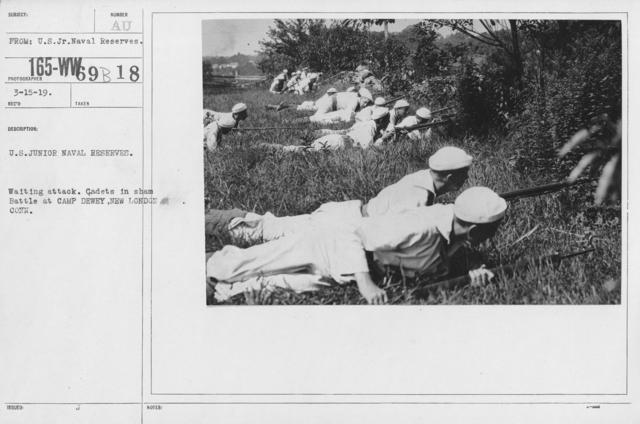 Boy's Activities - Junior Naval Reserve - Camp Dewey, Conn. - U.S. Junior Naval Reserves. Waiting attack. Cadetsin sham Battle at Camp Dewey, New London, Conn