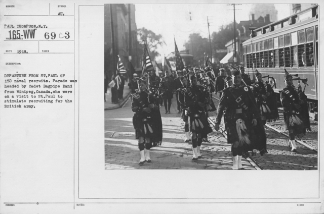 Boy's Activities - Junior Naval Reserve - Other Camps - Departure from St. Paul of 150 naval recruits. Parade was headed by Cadet Bagpipe Band from Winipeg, Canada, who were on a visit to St. Paul to stimulate recruiting for the British Army