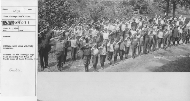 Boy's Activities - Patriotism - Chicago boys show military learning. Members of the Chicago Boys' Club saluting the flag at their camp at Lake Winona, Ill