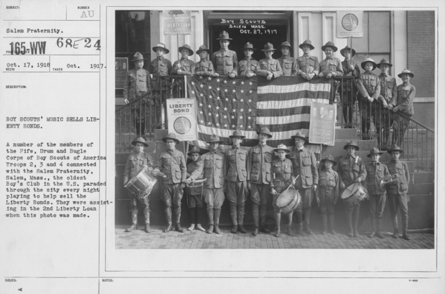 Boy's Activities - War Work - Boy Scouts' music sells Liberty Bonds. A number of the members of the Fife, Drum and Bugle Corps of Boy Scouts of America Troops 2, 3, and 4 connected with the Salem Fraternity, Salem, Mass., the oldest Boy's Club in the U.S. paraded throug the city every night playing to help sell the Liberty Bonds. They were assiting in the 2nd Liberty Loan when this photo was made