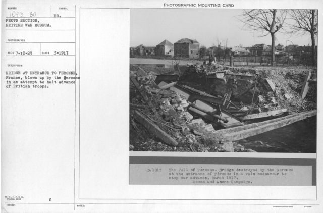 Brigade at entrance to Peronne, France, blown up by the Germans in an attempt to halt advance of British troops