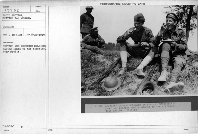 British and American soldiers having lunch by the roadside. Near moulle; 5/22/1918