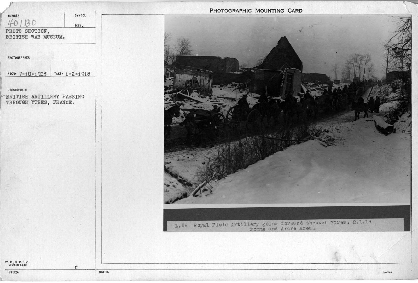 British Artillery passing through Ytres, France; 1/2/1918