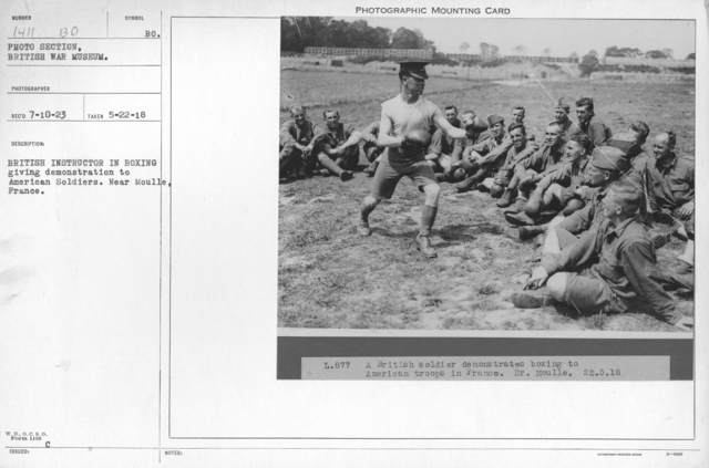 British instructor in boxing giving demonstration to American soldiers. Near Moulle, France