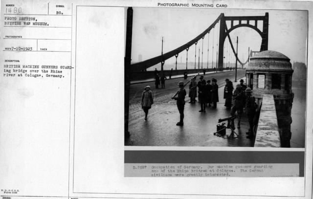 British Machine Gunner guarding bridge over the Rhine River at Cologne, Germany