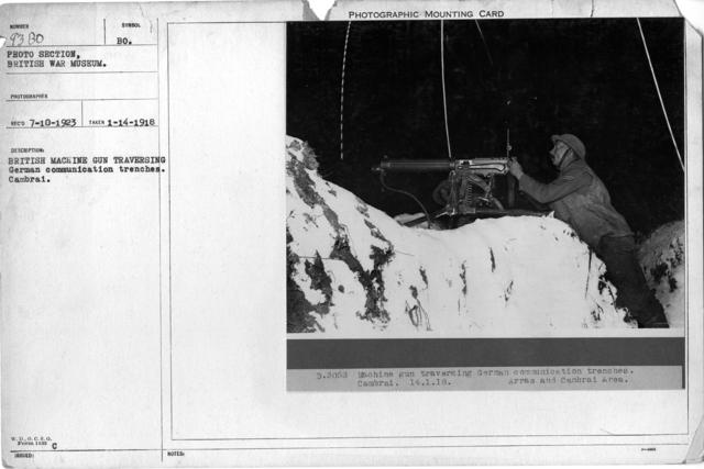 British Machine Gunner traversing German communication trenches. Cambrai