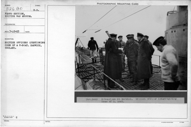 British officers questioning crew of a U-boat. Harwich, England