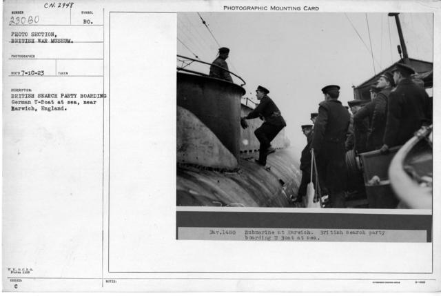 British sear party boarding German U-boat at sea, near Harwich, England