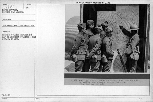British soldier explaining map to American soldiers. Near Moulle, France; 5/22/1918