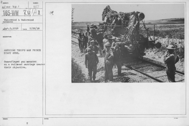 Camouflage - Artillery - American Troops man French heavy guns. Camouflaged gun mounted on a railroad carriage nearer their objective