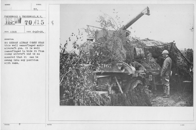 Camouflage - Artillery - No German airman comes near this well camouflaged anti-aircraft gun. It is well camouflaged to hide it from enemy aircraft and is so mounted that it can be swing into any position with ease