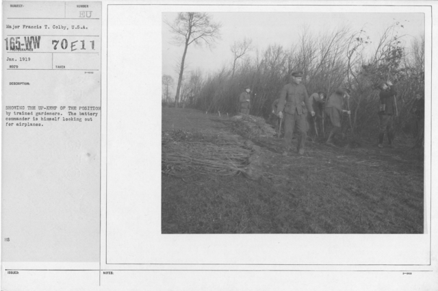 Camouflage - Roads - Showing the up-keep of the position by trained gardeners. The battery commander is himself out for airplanes