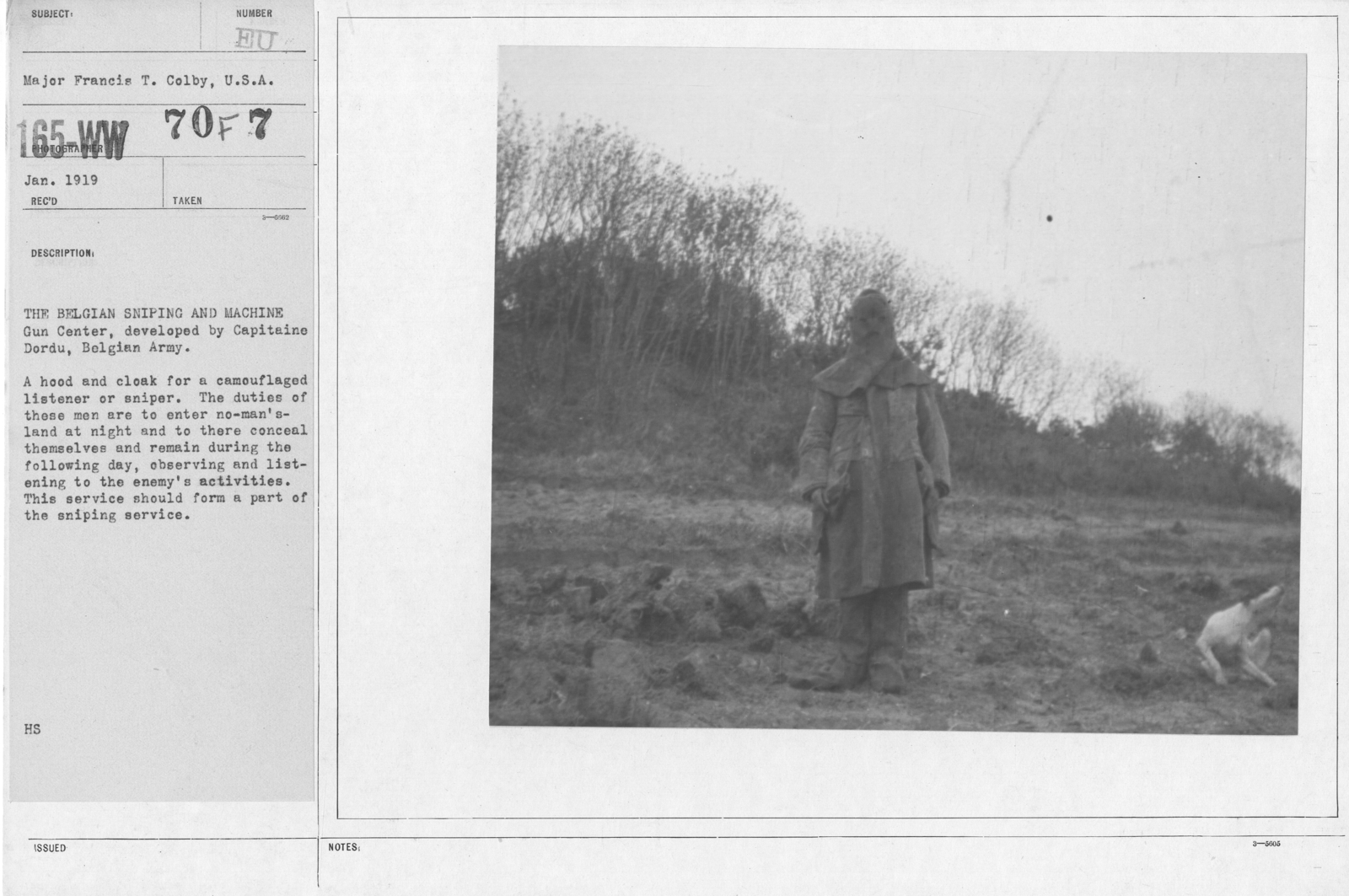 Camouflage - Scouts - The Belgian Sniping and Machine Gun Center, developed by Capitaine Dordu, Belgian Army. A hood and cloak for a camouflaged listener or sniper. The duties of these men are are to enter no-man's-land at night and to there conceal themselves and remain during the following day, observing and listening to the enemy's activities. This service should form a part of the sniping service