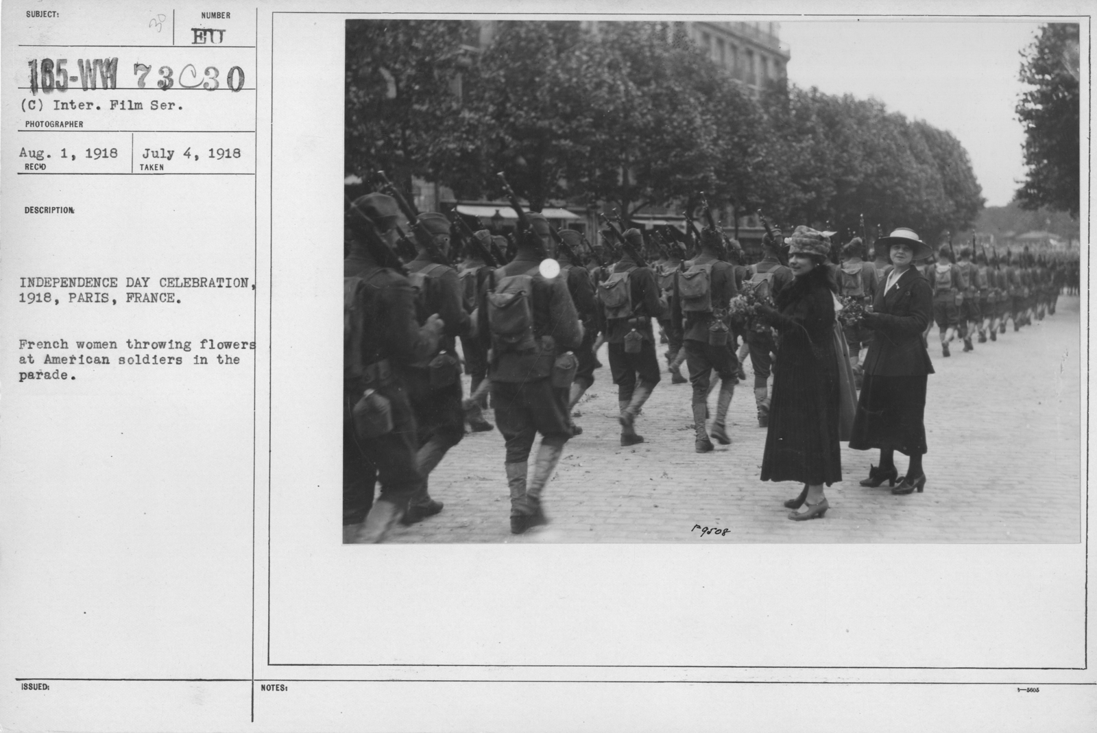 Ceremonies - American Independence Day, 1918 - France - Independence Day Celebration, 1918, Paris, France. French women throwing flowers at American soldiers in the parade