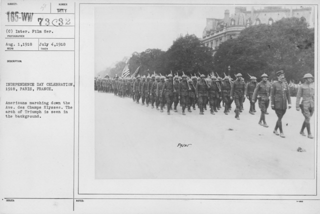 Ceremonies - American Independence Day, 1918 - France - Independence Day Celebration, 1918, Paris, France. Americans marching down the Ave. des Champs Elysses. The arch of Triumph is seen in the backyard