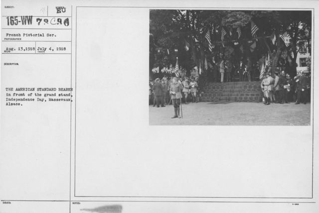 Ceremonies - American Independence Day, 1918 - France - The American Standard Bearer in front of the grand stand, Independence Day, Massevaux, Alsace