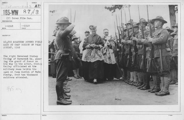 Ceremonies and Parades - 10,000 soldiers attend field mass at Camp Gordon on Palm Sunday, 1918.  The right Reverand Bishop Keiley of Savannah, Ga. Passing the Guard of Honor on his way to the alter.  Bishop Keiley officiated at the military mass held in the open at Camp Gordon of Palm Sunday.  Over ten thousand soldiers attended