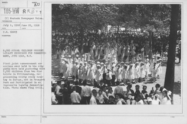 Ceremonies and Parades - 5,000 school children present loyalty exercises for commencement, June 1918, N. Y.  First joint commencement exercises ever held in the city parks were held yesterday when 5,000 children from two districts in Williamsburg, representing nearly every country in Europe, met in Prospect Park and participated in an impressive loyalty demonstration.  Photo shows flag drill