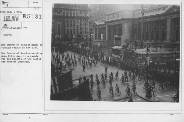 Ceremonies and Parades - Boy Scouts of America march in victory parade in New York.  Boy Scouts of America marching down Fifth Ave. in a parade for the benefit of the United War Workers Campaign