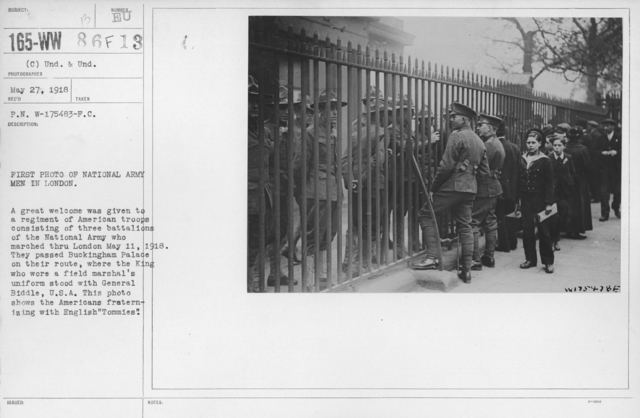 "Ceremonies and Parades - First photo of National Army men in London.  A great welcome was given to a regiment of American troops consisting of three battalions of the National Army who marched thru London May 11, 1918.  They passed Buckingham Palace on their route, where the King who wore a field marshal's uniform stood with General Biddle, U.S.A.  This photo shows the Americans fraternizing with English ""Tommies"""