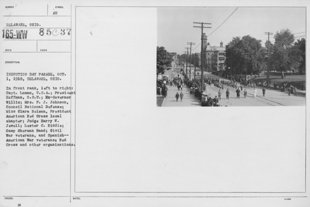 Ceremonies and Parades - Induction Day Parade, Oct. 1, 1918, Deleware, Ohio.  In front rank, left to right:  Capt. Loman, U.S.A.; President Hoffman, O.S.U., Ex-Governor Willis, Mrs. F.J. Johnson, Council National Defense; Miss Clara Nelson, President American Red Cross Local Chapter; Judge Harry W. Jewell; Lester C. Riddle; Campt Sherman Band; Civil War veterans, and Spanish-American War veterans; Red Cross and other organizations